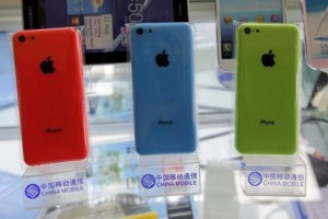 Apple's iPhone 5Cs are displayed on racks bearing the logo of China Mobile in Beijing